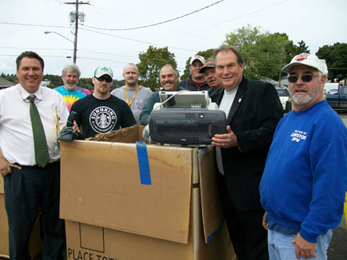 Richard Pope, far left, director of the Niagara County Refuse Disposal District, and Niagara County Legislator John Ceretto (holding a printer) joined in electronics recycling day alongside members of the Village of Lewiston Department of Public Works, Niagara County Landfill and Recycling, and Sunnking Electronics Recycler.
