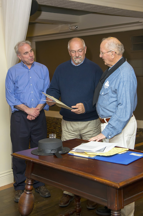 Pictured, from left, Lee Simonson and Bruce Sutherland, Historical Association president, accept a copy of a letter from Alex Millard from Fischer. (photo by Wayne Peters)