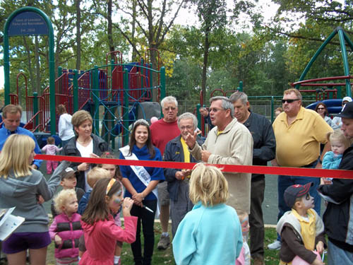 The Town of Lewiston held a grand re-opening of the playground at Kiwanis Park on Sept. 25. Shown at the ribbon cutting of the new, state-of-the-art facilities were assorted local elected officials; members of the Kiwanis Club of Lewiston; Courtney Corbetta, newly crowned Peach Queen; and a host of area families and children.