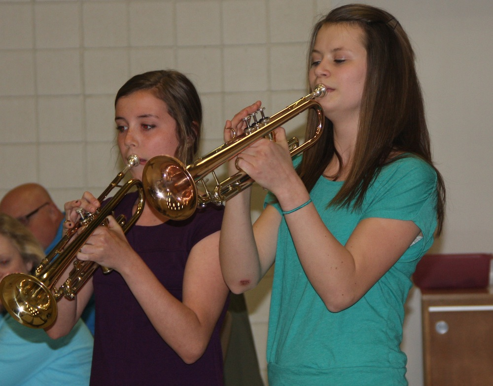 Kelsey Oliverio and Sarah Andres perform at the Lew-Port Board of Education meeting.