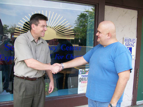 Rivershore Inc. Executive Director Jeff Sanderson, left, poses with James `Jim` Miller outside of the agency's Lewiston office.
