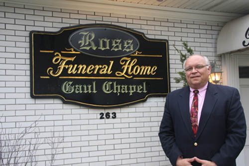 Michael Ross in front of the former Gaul Funeral Home in Lockport, one of two local chapels purchased by Ross and his family. (photo by Janet Schultz)