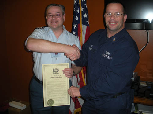 Flotilla Commander Marty Laufer (left) presents the safe boating proclamation, issued by Village of Lewiston Mayor Terry Collesano, to Officer in Charge of U.S. Coast Guard Station Niagara Chief Robert Snow.