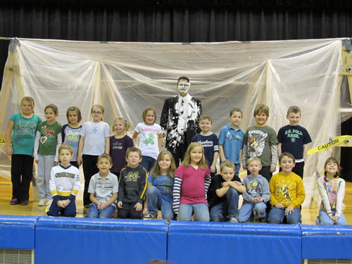 Stevenson Elementary Principal Michael Cancilla, shown with the PARP assembly students who participated in the pie-throwing.