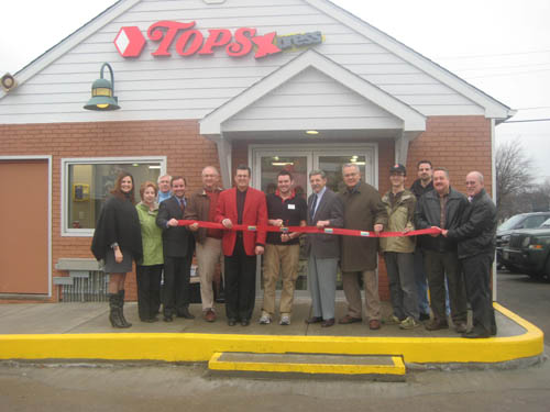 Tops Xpress has opened on the corner of South Eighth and Cayuga streets in the Village of Lewiston. The Niagara River Region Chamber of Commerce, along with the Village and Town of Lewiston, assisted in celebrating a ribbon-cutting ceremony in honor of the grand opening on Monday.   The new gas and convenience store is owned and operated by DiMino's Lewiston Market Inc. John DiMino is manager of the Tops Xpress location.   Pictured from left: Jennifer Pauly, president of the NRRCC; Village of Lewiston Clerk Anne Welch; Sentinel Publisher Skip Mazenauer; Town of Lewiston Councilman Mike Marra; Anthony DiMino; John DiMino; Village of Lewiston Mayor Terry Collesano; NRRCC Board Chairman and Artpark & Co. President George Osborne; and NRRCC board members Michael Broderick, Rick Haight, Fred Blue and Jeff Stolar.