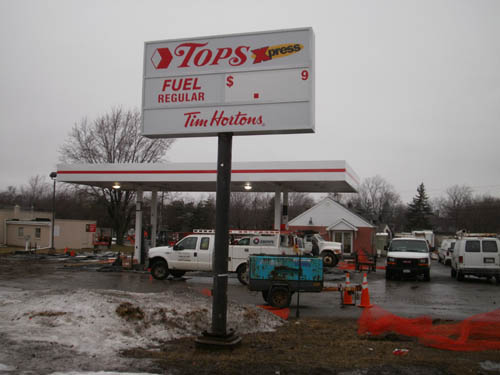 The Tops Xpress gas station now has the store's trademark logo and red and white stripe. (photo by Joshua Maloni)