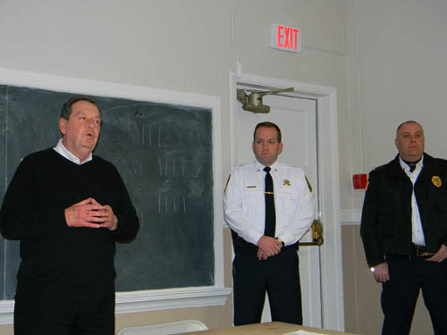 Village of Youngstown Mayor Neil Riordan discusses the recent wave of break-ins in the village. To his right are Administrative Capt. Michael J. Filicetti of the Niagara County Sheriff's Office and Youngstown Police Lt. Mike Schuey.
