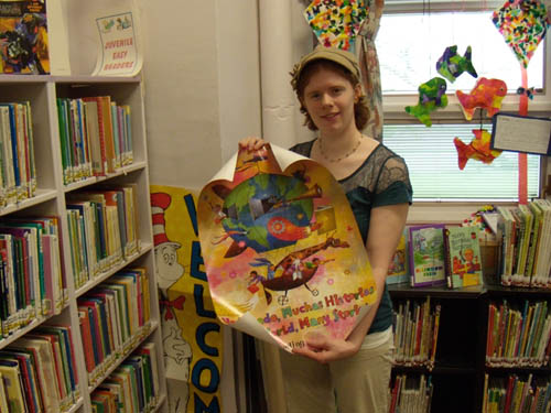 Staffer Amanda Free assists at the Youngstown Free Library.