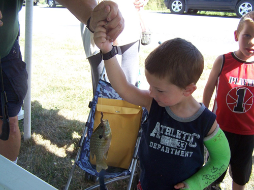 The Niagara River Anglers provided this youngster with the thrill of the catch at the Waste Management picnic last Friday.