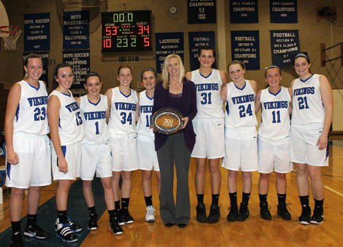 The Grand Island Vikings girls varsity basketball players gave their coach Jen Banker her 300th victory as a head coach with a 53-34 win over visiting Kenmore East on Jan. 12. After the Ken-East game, Banker had 223 victories in high school and 77 more at the collegiate level. Pictured, from left, are Stephanie Knight, Grace Olszewski, Jessica Amsdill, Megan Karpie, Megan O'Leary, Jen Banker, Cassie Oursler, Kallie Banker, Stephanie Senn and Kassie Bennett. (photo by Larry Austin)
