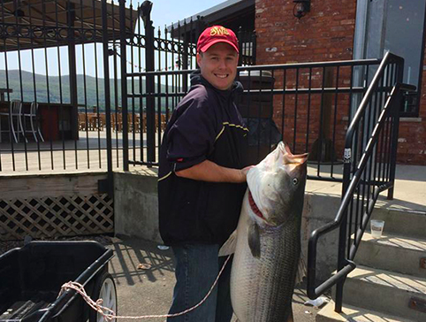 Eric Lester holds his 60-pound state record inland striped bass he caught May 14 from the Hudson River in Orange County.