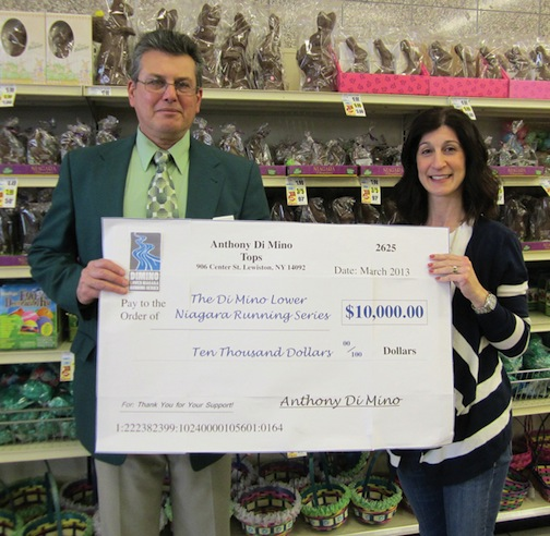Anthony DiMino, owner of Tops in Lewiston, presents a donation of $10,000 for The DiMino Lower Niagara Running Series to Maureen Rizzo of Niagara Hospice Alliance.
