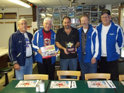 Shown from left are Russ Fleetwood, son of a FOAR SCORE founder; Bob Deull; Sal Buscaglia, co-owner of Salisa's All American Diner; Paul Faleski; FOAR SCORE president; and Bill Anstett.