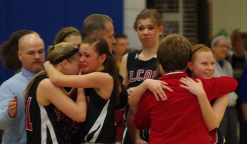 Members of the Niagara-Wheatfield girls basketball team gather on the sidelines as the Section VI Class AA championship game comes to an end. (photo by Larry Austin)