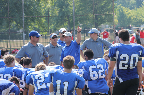 Grand Island football coach Dean Santorio talks to his team following a scrimmage on Saturday. The scrimmage hosted Lockport, Williamsville South, Niagara-Wheatfield, Sweet Home and St. Francis. (photo by Larry Austin)