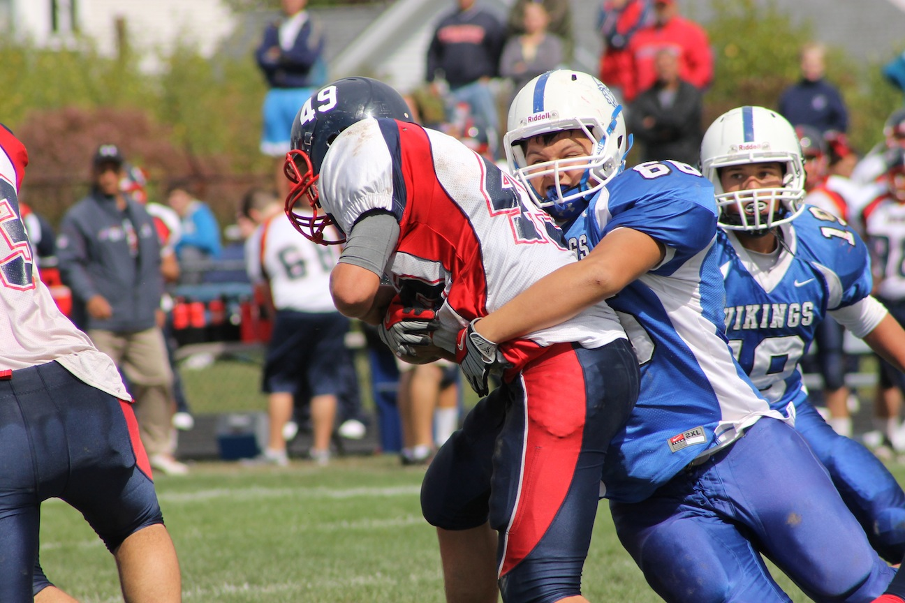 Grand Island's Joe Gioeli wraps up a North Tonawanda ballcarrier during the Vikings' 35-21 win Saturday at Masters Field. (photo by Larry Austin)