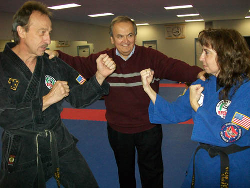 Grandmaster Jim Wood and his wife, Nina, strike a karate stance for State Sen. George Maziarz. (photo by Joshua Maloni)