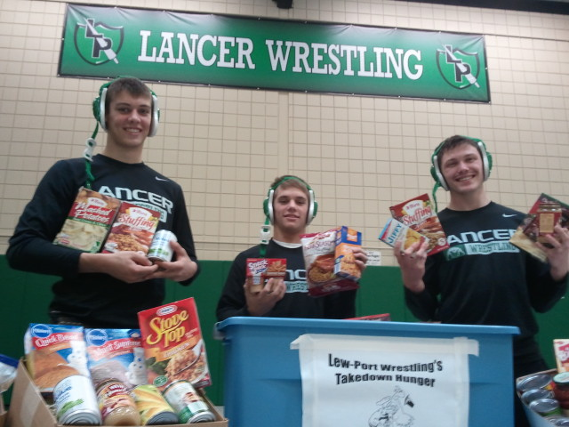Lancers' mat men, from left, Jason Kromer, Dan Reagan and Matthew Jeffords.