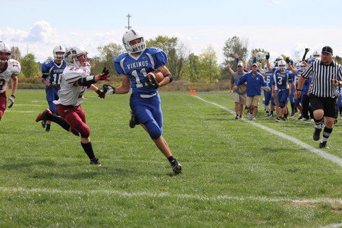 Grand Island running back Mitch Fachko turns the corner on his way to the end zone on an 18-yard touchdown run during a 31-14 win against Starpoint on Saturday. (photo by Larry Austin)