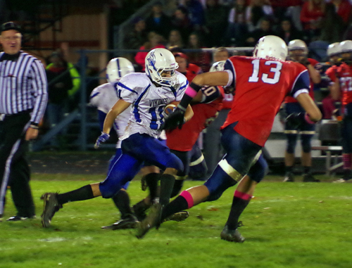 Grand Island running back Mitch Fachko breaks into the second level of the Iroquois defense on the way to a game-winning 52-yard touchdown run Friday night in Elma. The Vikings won 27-20 and will play at Sweet Home Saturday at 2 p.m. (photo by Larry Austin)