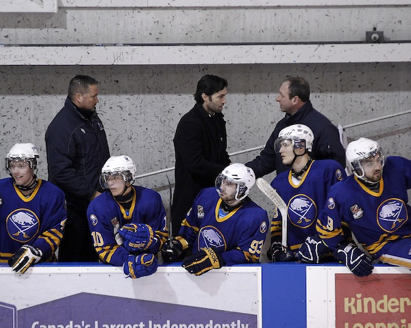 Michael Peca (center) behind the bench in the OJHL.