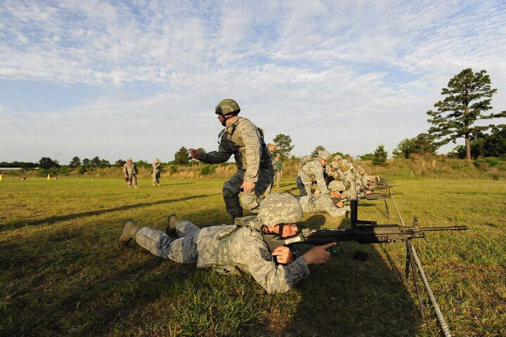 Air Guard Master Sgt. Edward Stefik, standing, and Air Guard Tech Sgt. Warren Jones, engage targets with an M240B machine gun during the Winston P. Wilson Championship Match.