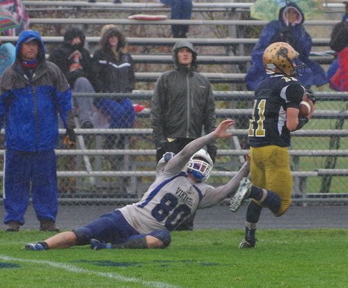 Grand Island receiver Chris Connors dives in vain to tackle Sweet Home defensive back Ethan Reger after an interception in the second half of Saturday's Section VI Football Federation Class A semifinal game. (photo by Larry Austin)