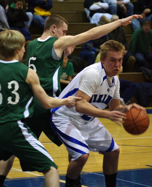 Liam Dodd drives in the lane against Lake Shore. (photo by Larry Austin)