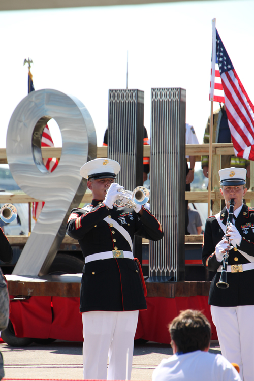 Members of the U.S. Marine Corps Band perform in front of `Standing Tall,` a 7-foot steel 9/11 memorial, created by Steel Crazy Iron Art of Buffalo at the request of Col. Mark Murphy. (photo by Thomas Cannuli)