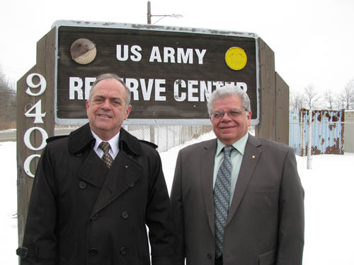 Dan Bristol, executive director of the Town of Niagara Local Redevelopment Authority, left, and Town Supervisor Steve Richards are shown at the gate of the U.S. Army Reserve Center on Porter Road. (photo by Susan Mikula Campbell)
