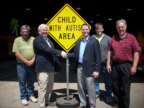 Wheatfield Supervisor Bob Cliffe, left, and North Tonawanda Mayor Robert Ortt, flank the `Child With Autism Area` sign the city provided for the town.
