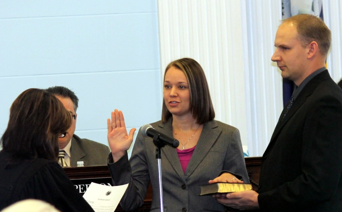 Copelin oath: Niagara County Legislator Cheree Copelin recites her oath of office Monday at Niagara Falls City Hall, as her husband, Luke, a Niagara Falls firefighter, holds the family Bible. Administering the oath is City Judge Diane Vitello. Copelin, who was appointed to fill a vacancy created by the resignation of Legislator Vincent M. Sandonato, was elected in her own right in November.
