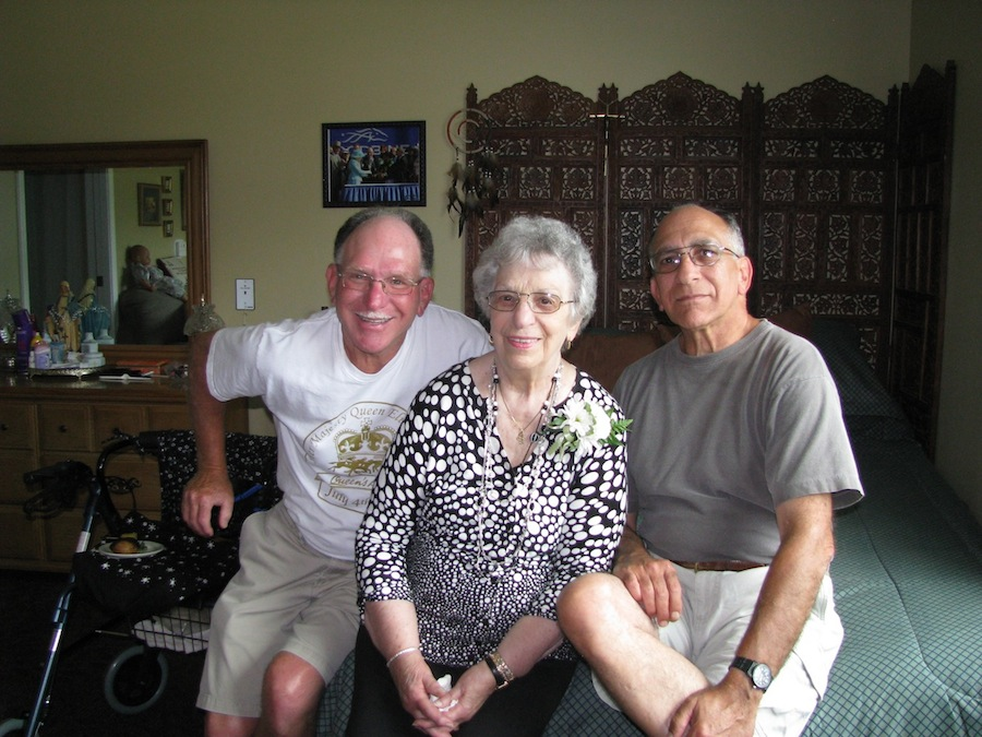 Former Town of Niagara resident Anne Gonzalez is pictured with her sons Nick, left, and Jeff in her room at ElderWood Assisted Living at Crestwood.