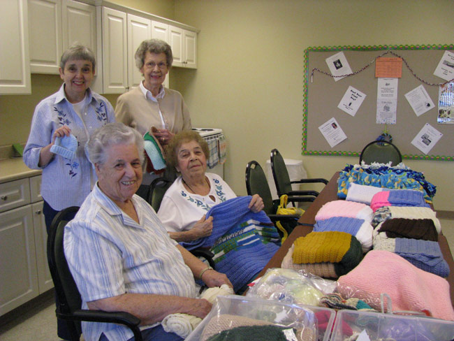 Above, some of the members of Crafting for a Cause show off items their group has made to donate to various charitable groups. From left are Beverley Gounard-Spry, 67; Zilcie Brooks, 91; Arleta Schreiber, 85; and Mary Catania, 95.