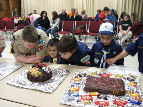 Members of Cub Scout Pack 833 started collecting donations of items to send to soldiers overseas at their group's fundraising Cake Auction last week.