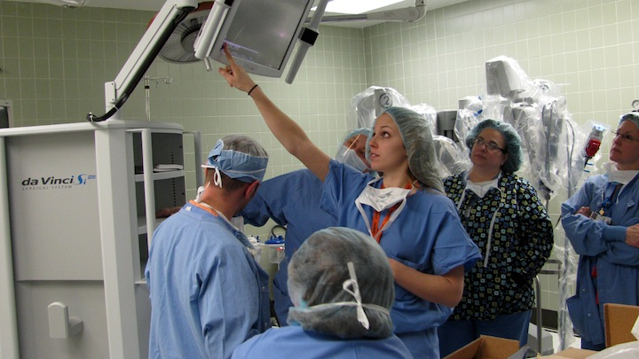 Niagara Falls Memorial Medical Center surgery team members and a representative from Intuit Surgical Inc., manufacturer of the da Vinci Si Surgical System, install the new surgical technology.