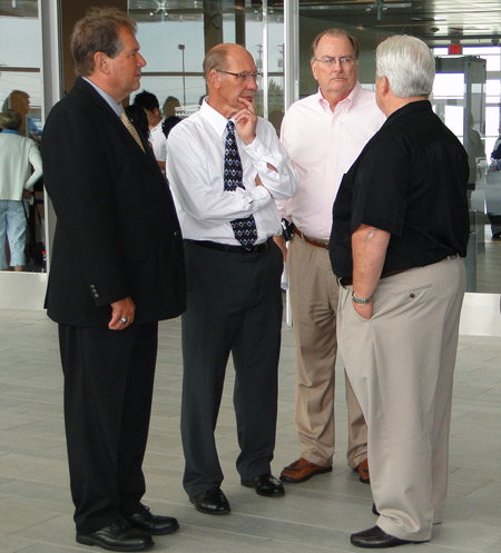 Direct Air President Ed Warneck, right, chats with Niagara County Legislators John D. Ceretto, R-Lewiston, and Danny W. Sklarski, D-Niagara, and James W. Ward, executive advisor to State Sen. George D. Maziarz, R-N