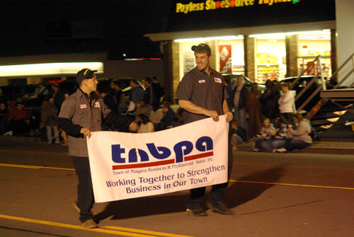The Town of Niagara Business and Professional Association will continue the tradition of collecting food for the needy at the annual Electric Lights Parade this year.
