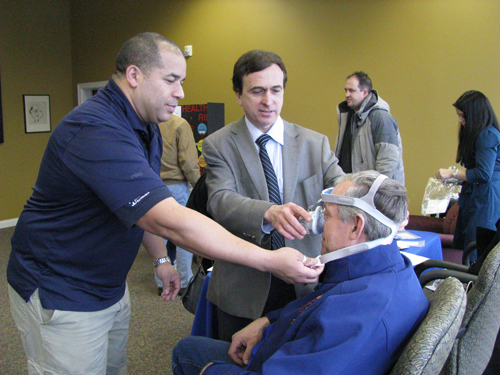 Byron Figueras, respiratory therapist, and Dr. Edward Ventresca try a new Philips Respironics CPAP mask on Wheatfield resident Art Kroening at Health System Services.