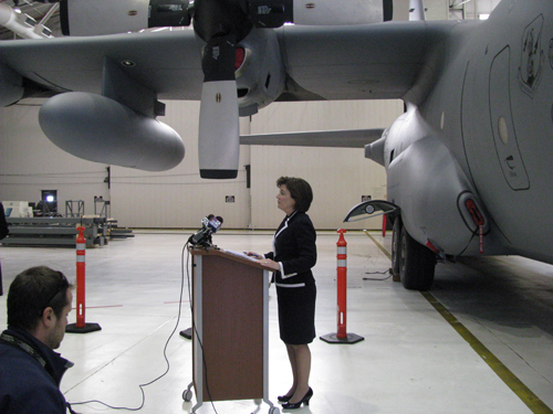Congresswoman Kathy Hochul spoke to the press in front of one of the Niagara Falls Air Reserve Station's C-130 aircraft on Tuesday.