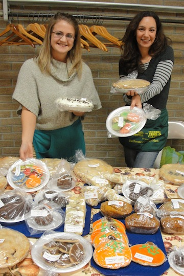Volunteers Becky Bierlein and Gina Darlak display some of the treats on sale at last year's Holy Ghost Election Day sale.