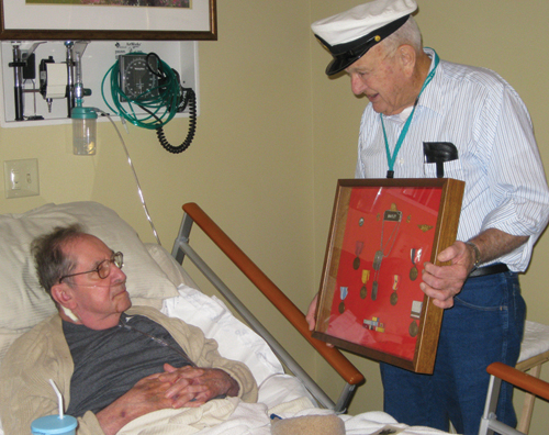 Navy veteran and Niagara Hospice volunteer Gene Brayley visited with Army veteran Ralph Bishop during his stay at Niagara Hospice House. Ralph guarded both presidents Truman and Eisenhower.
