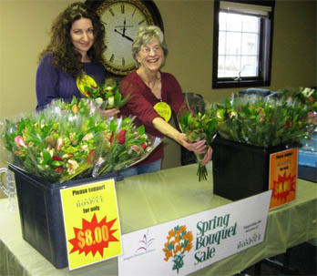 Niagara Hospice volunteers Mary Rickert and June Koepcke sell bouquets at last year's Hospice spring bouquet sale.