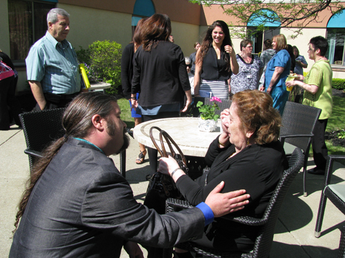Nate Kennedy, associate director of hospice and palliative care at Northgate, comforts Rose Zinati after the ceremony naming the new hospice wing at Northgate in honor of her late daughter, Jeanne D'Arc Abou-Antoun.