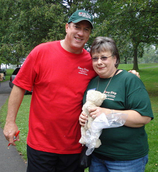 Jim Kelly and NCFCU receptionist Mary Anne Payne are shown at the 2008 Every Step Walk.