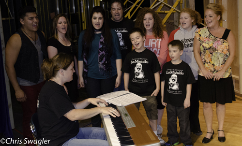 Niagara-Wheatfield-area residents Marnie Williams Aldrow at keyboard, and, from left, Max Antone, Katie Junevic-Bolden, Kacy Carbone, Eric Fesmire, Samuel Fesmire, Lindsey Clark, Isaac Fesmire, Jenna Montesanti and Andrea Sarles-Letcher are part of Theatre in the Mist's production of `Les Misérables` from Oct. 11-26 at Niagara Falls High School.