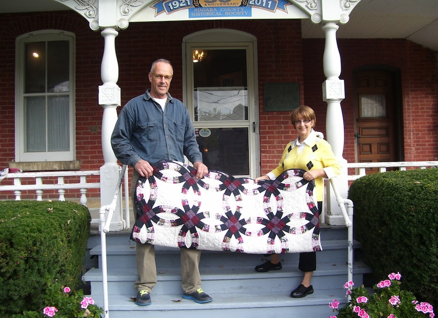 Paul and Paula Mayers of Lockport are shown at the Niagara History Center with their double-wedding-ring Amish quilt, won in the History Center's 25th annual quilt drawing.