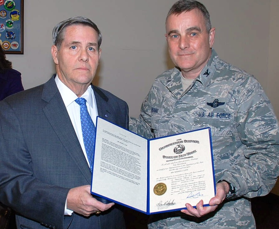 Merrell Lane receives the New York State Conspicuous Service Medal from Col. John Higgins, commander of the 107th Airlift Wing, on Saturday, March 9. (photo courtesy of the NYS Division of Military and Naval Affairs)