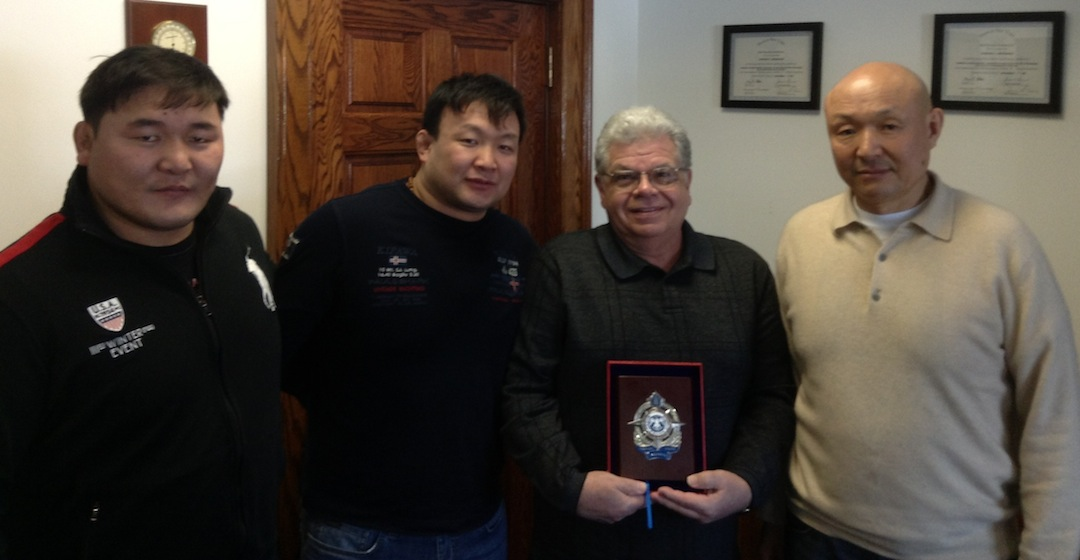 Travelers from Mongolia visited the Town of Niagara Town Hall last week. From left are Mongolian Olympic champions Naidan Tuvshinbayar (judo) and Munkhsailhan Usukhbayar (wrestling) Town of Niagara Supervisor Steve Richards; and Pagva Bira, Ph.D., chairman of the National Authority Police Force (Khuch) Bayanzurkh District, Mongolia.