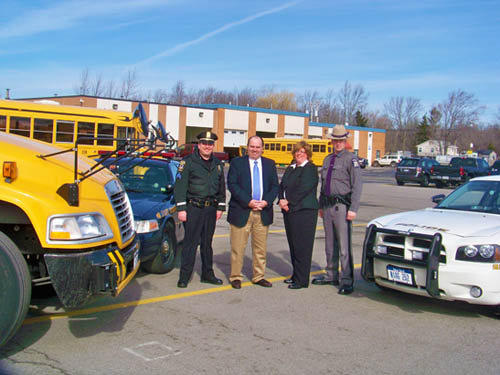 Promoting Operation Safe Stop on Wednesday, March 30, from left, are Sgt. Jeffrey Spears of the Town of Niagara Police; Michael Dallessandro, Niagara-Wheatfield Transportation Department supervisor; Margaret A. Messer, Niagara-Wheatfield head bus driver/safety coordinator; and State Trooper James J. O'Callaghan. (photo by Tracy Bloom)